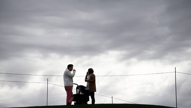 Storm clouds darken the sky as spectators watch the action during the Kyocera Pro-Am on The Stadium Course at TPC Scottsdale on Jan. 26 2015 in Scottsdale.