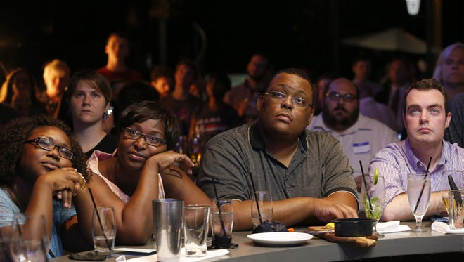 Patrons watch the televised Democratic Debate at The Edison restaurant in Cascades Park on Tuesday.