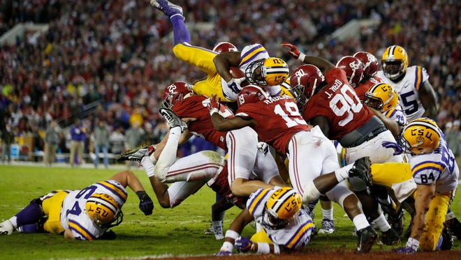 LSU running back Leonard Fournette (7) tries to reach the end zone as the Alabama defense holds at the line in the second half of an NCAA college football game Saturday, Nov. 7, 2015, in Tuscaloosa , Ala. (AP Photo/John Bazemore)