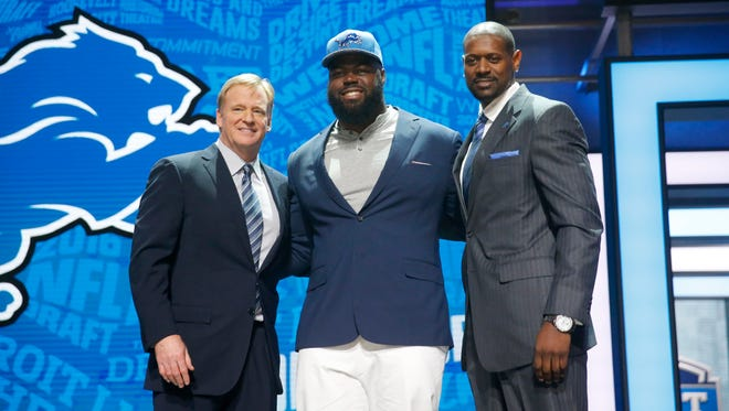 A'Shawn Robinson shares the stage with Roger Goodell and former Lions receiver Herman Moore on Friday night.