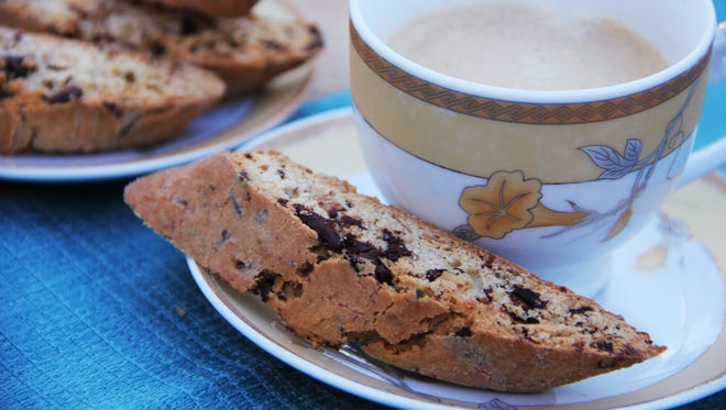 This Nov. 1, 2016 photo shows dark chocolate and rosemary biscotti in Coronado, Calif. This recipe for biscotti, the firm, dry Italian cookie, is flavored with dark chocolate and rosemary because they are classic winter flavors.