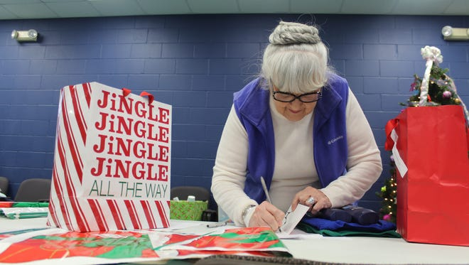 Sue Templin helps sort out gifts for the local Gift Lift program, providing Christmas gifts to those who might be forgotten.
