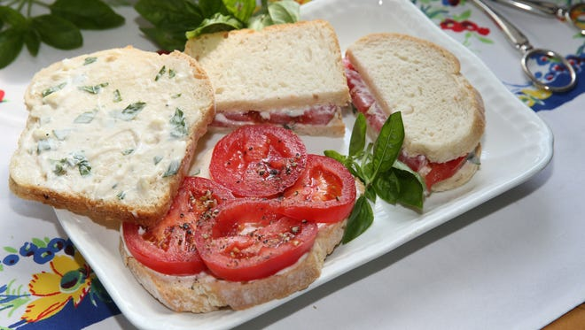 The humble tomato sandwich, here with basil mayonnaise, can be made on firm white bread or soft.