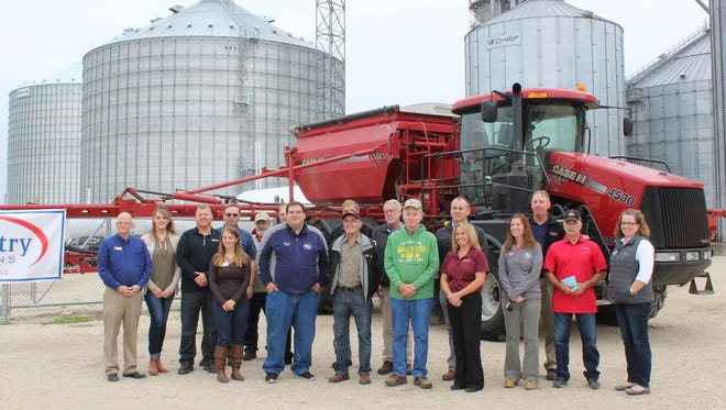 Lawmakers, county and state officials, board members and company employees gather in front of one of Country Visions Cooperative's field applicators following the conclusion of their tour on Oct. 6.