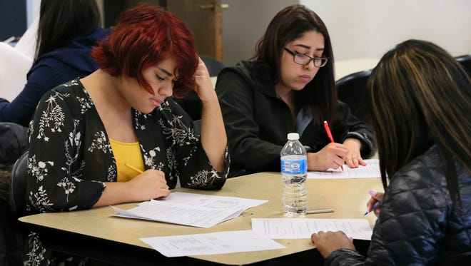 Alex Hernandez (left) and Leslie Moreno, take an exam in a class at Alverno College dealing with working effectively within diverse groups of people.