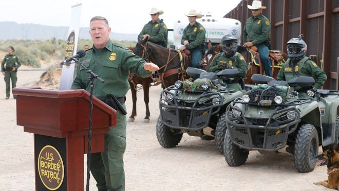 Aaron Hull, Chief Patrol Agent of the El Paso Sector U. S. Border Patrol, U. S. Customs and Border Protection, addresses the media in Santa Teresa, N.M., where construction of the new border wall began Monday.