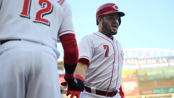Cincinnati Reds third baseman Eugenio Suarez (7) is congratulated by Cincinnati Reds shortstop Rosell Herrera (12) after hitting a two-run home run in the first inning during a National League baseball game between the Milwaukee Brewers and the Cincinnati Reds, Tuesday, May 1, 2018, at Great American Ball Park in Cincinnati.