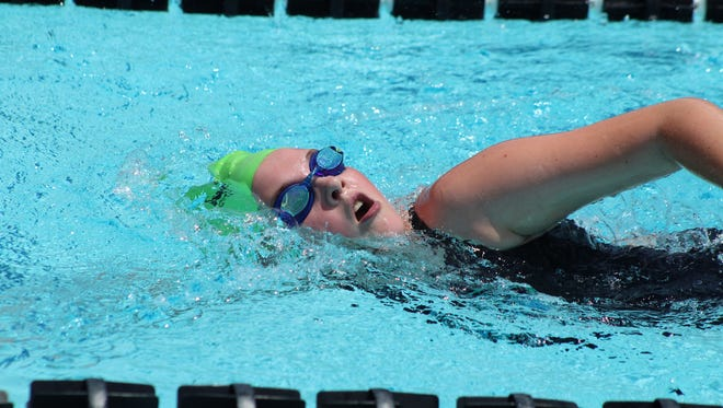 Mountain Home Hurricane swimmer Marlee Brashear competes in a 12-and-under freestyle race Saturday at Jonesboro.