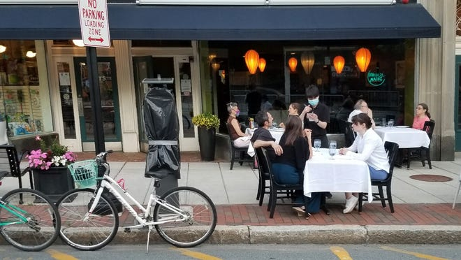 Patou in Belmont Center takes advantage of the town's outdoor dining plan, offering seating for customers on the sidewalk and in the parking lane in front if its Leonard Street address.