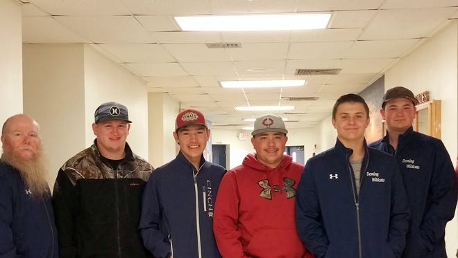 """The Deming High School Wildcat Bowling Team is, from left, Assistant Coach Sonny Garney, Armado Perales III, Aaron """"Nemo"""" Perales, Sabastian Camacho, Jared Morgan, Ronnie Simmons and Head Coach Richard Perales."""