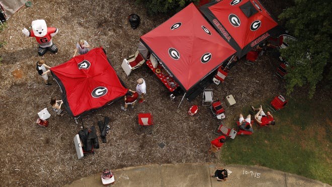 Bulldog fans tailgate outside the Georgia Center for Continuing Education before the start of a game against Vanderbilt in October 2018. The University of Georgia has banned such tailgating on campus this year.