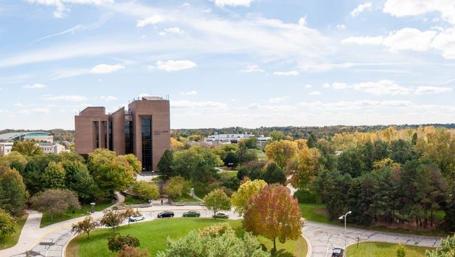A panorama of the UW-Green Bay campus with the David A. Cofrin Library standing tall in the middle.