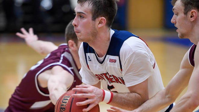 University of Southern Indiana's Nate Hansen (5) drives into the paint as the USI Screaming Eagles play the Bellarmine Knights at USI's Physical Activities Center Saturday, February 10, 2018.