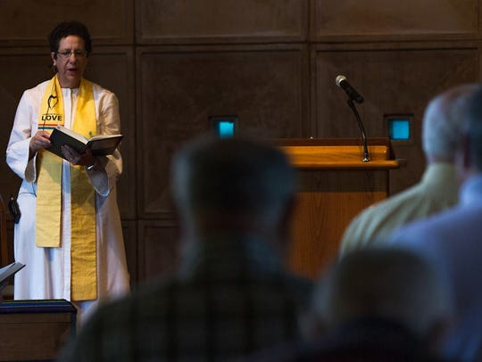 The Rev. Roberta Finkelstein sings a hymn during services