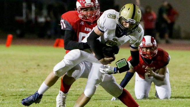 Nathan Kelly pressured and sacked. The Desert Mirage varsity football team won Friday's home conference game against Desert Hot Springs by a score of 35-27.