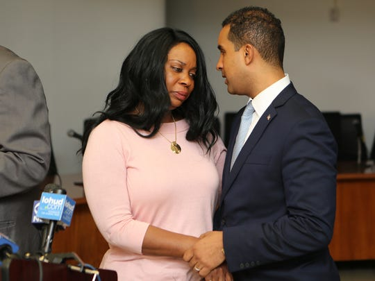 Mount Vernon Mayor Richard Thomas comforts Nadine McKenzie, mother of Shamoya McKenzie, during a press conference at the Board of Education in Mount Vernon, Jan. 3, 2017.