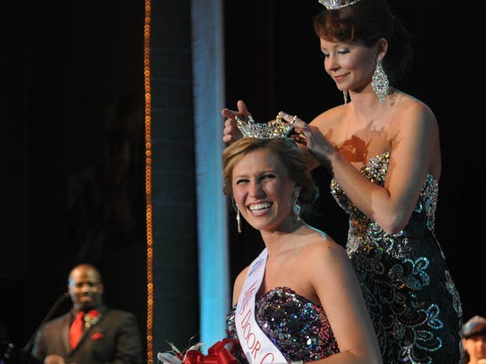 FEBRUARY: Miss Door County 2013 Samantha Cole secures the crown on Cora Baudhuin after she was selected Miss Door County 2014 on Feb. 1 at the Southern Door Community Auditorium. Runnerup was Susan Fochs. Crowned Door County's Outstanding Teen is Sophia Pollman.