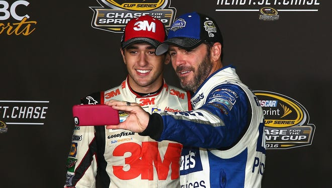 Jimmie Johnson, right, shown with Chase Elliott, will be trying for his seventh NASCAR title.