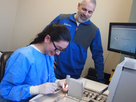 Silver Lake College graduate Thao King landed a job as a lab assistant at Forefront Dermatology in Manitowoc, after having served an internship in the histology lab during college. She is pictured with Lee Loss, Forefront Dermatology's director of laboratory services.