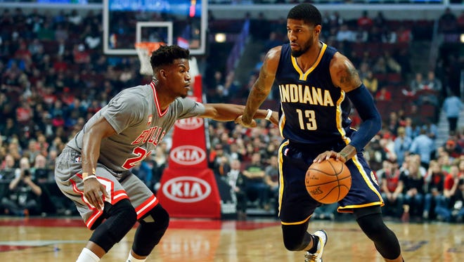 Indiana Pacers forward Paul George (13) drives against Chicago Bulls guard Jimmy Butler (21) during the first half at United Center.