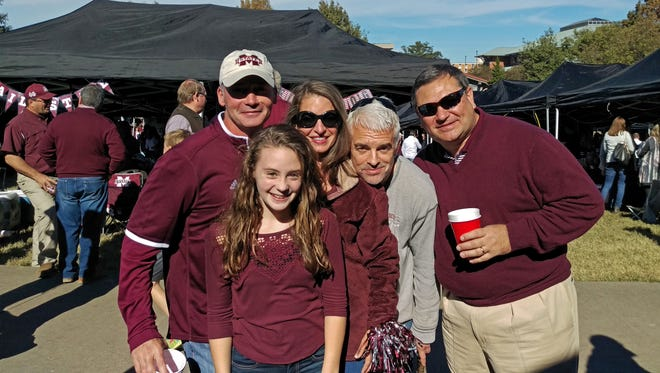 From left: Darrel Bolin, and unidentified girl, Donna Echols, Neely Tucker and Bubba Carroll at last week's tailgate on Mississippi State's campus.