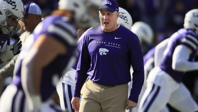 FILE - In this Nov. 16, 2019, file photo, Kansas State head coach Chris Klieman warms up his team before an NCAA college football game against West Virginia in Manhattan, Kan. Kansas State football players say they will boycott all team activities until administrators create a policy that would allow a student to be expelled for an openly racist, threatening or disrespectful actions.