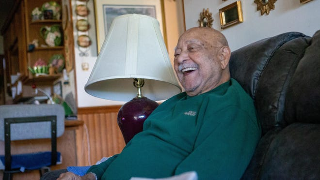 Close to celebrating his 90th birthday, Jack Alexander laughs as he talks about the amount of time he spends at this spot on the couch Friday afternoon. Alexander is best known as the only Black man to be elected to the Topeka City Commission before the city changed to a council form of government in 1985.