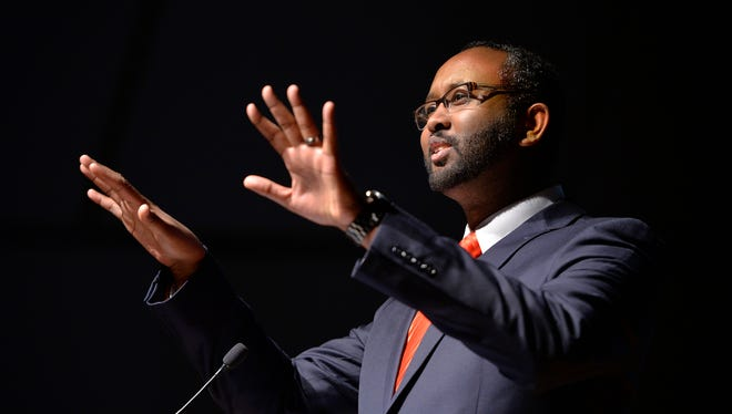 "Jaylani Hussein, the director of the Council on American Islamic Relations of Minnesota delivers his speech titled ""Muslims in Minnesota"" Tuesday evening on stage at St. Cloud State University's Ritsche Auditorium. Hundreds turned out for the event."