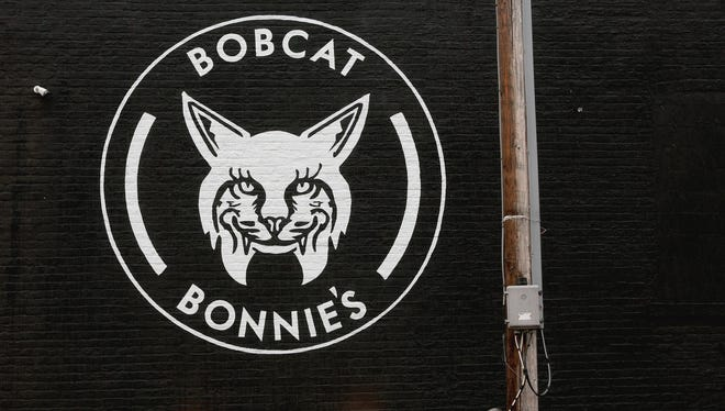 The eye-catching Bobcat Bonnie's emblem is easy to see as you're driving down Michigan Avenue near Trumbull.  The painted sign on the side of the building was designed by Jordan Zielke and Kelly Gold of the Detroit-based Golden Sign Company. The couple have been leaving their artistic mark on various businesses that pay them to make unique and iconic signs. The Bobcat Bonnie's sign was photographed on Friday, January 8, 2016.