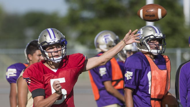 Fort Collins High School quarterback Jonathan Erickson throws a pass during practice Tuesday. The senior transferred from New Mexico and will start for the Lambkins.