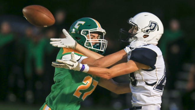 Floyd Central's Lucas Moser breaks up an end zone pass for Providence's Manny Schmidt in the second half.