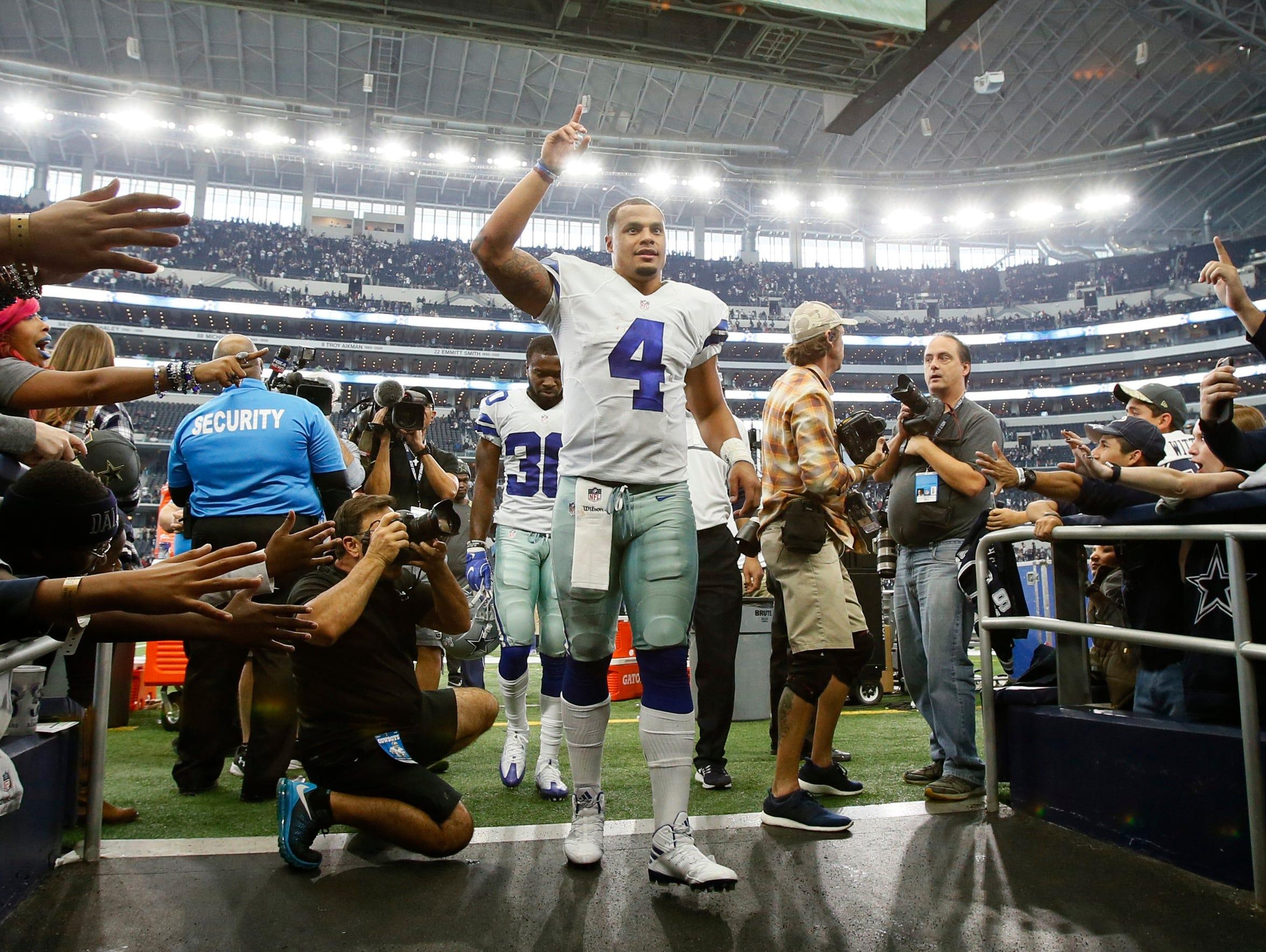 Dallas Cowboys quarterback Dak Prescott (4) leaves