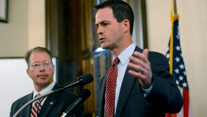 Speaker of the House Kevin Cotter, R-Mt. Pleasant, right, and State Rep. Dan Lauwers, R-Brockway, talk to the media Thursday May 19, 2016, about their proposal to overhaul Michigan's civil service system and make it easier to discipline and remove problem employees.