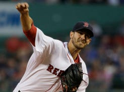 Boston pitcher Rick Porcello delivers in the first inning against the Yankees at Fenway Park on Tuesday. (AP Photo/Steven Senne)