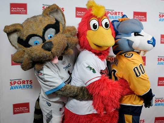 T-Rac, the Tittans' mascot; Booster, the Sounds' mascot, and Gnash, the Preds' mascot, pose on the red carpet at the third annual Tennessean Sports Awards presented by Farm Bureau Health Plans Sunday, June 3, 2018, at Music City Center in Nashville, Tenn.