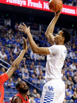 Kentucky's Skal Labissiere, right, shoots over NJIT's Terrence Smith, partially in frame at left, and Tim Coleman (2) during the first half of an NCAA college basketball game Saturday, Nov. 14, 2015, in Lexington, Ky.