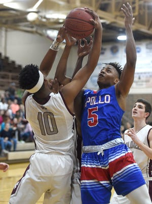 D.J. Mitchell of Henderson County pulls down a rebound in front of Dametrion Chambers of Apollo during the first quarter of the game at Colonel Gym in Henderson Tuesday.
