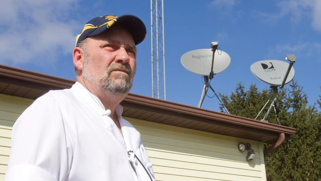"""Conway Township resident Chuck Skwirsk resorted to using a dish supplied by HughesNet over a month ago to improve his internet reception, since his Sprint service wasn't getting the job done. A service provided by FreedomNet seemed promising, since their tower was less than a mile away, but found he was in an """"interference zone."""""""