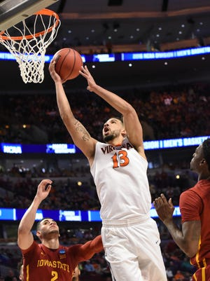 Virginia Cavaliers forward Anthony Gill (13) shoots over Iowa State Cyclones forward Abdel Nader (2) during the first half in a semifinal game in the Midwest regional of the NCAA Tournament at United Center.
