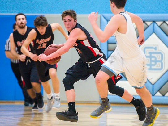 Rutland's Jacob Lorman brings the ball up the court