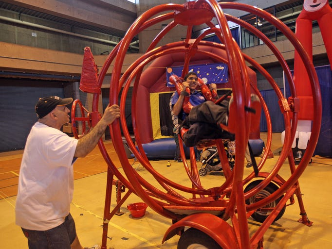 Camilo Isaza, 14, rides on the Gyroball which simulates the experience of weightlessness while attending the Northeast Astronomy Forum at Rockland Community College in Ramapo on April 12, 2014.