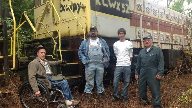 Sandy Duffy, left, T.J. Gaffney, Aaron Farmer and Bruce Sawdon of the Port Huron & Detroit Railroad Society were at the Knoxville Locomotive Works to look at engine No. 52.