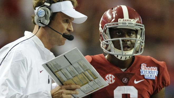 Alabama offensive coordinator Lane Kiffin consults with starting quarterback Blake Sims during Saturday?s 33-23 victory over West Virginia. Alabama offensive coordinator Lane Kiffin talks with quarterback Blake Sims (6) in the Chick-fil-A Kickoff Game at the Georgia Dome in Atlanta, Ga. on Saturday August 30, 2014.