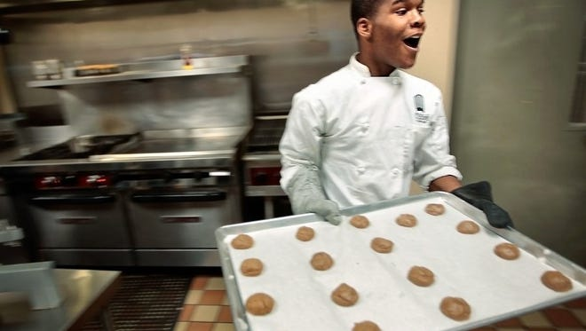 John Young works at the JIFF Intervention Program's kitchen while making chocolala cookies for Sweet LaLa's Bakery.