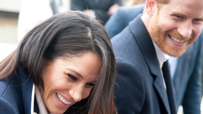 Britain's Prince Harry and his fiancee Meghan Markle arrive for an event for young women, as part of International Women's Day in Birmingham, central England on March 8, 2018.