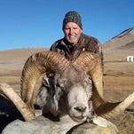 "This December 2012 photo shows Rick Vukasin, 65, of Great Falls, Mont., posing with a rare argali sheep known as the ""Marco Polo"" that he shot in the Pamir mountains of northeast Tajikistan near Karakul Lake along the Chinese border. Vukasin filed a lawsuit in U.S. District Court in Reno on Feb. 6 against a Tajikistani guide and Canadian outfitter he said defrauded him by shipping him horns taken from an animal other than the 58-inch long ones he says belonged to the sheep he shot."