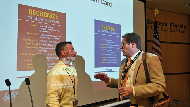 Michael Kelley, executive director of the Scott Center for Autism Treatment at Florida Tech,  with Michael Smith, who works in human resources at Brevard Public Schools and is also the parent of an autistic adult, at the close of the training session.
