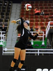 Wylie's Keetyn Davis (9) serves the ball during the