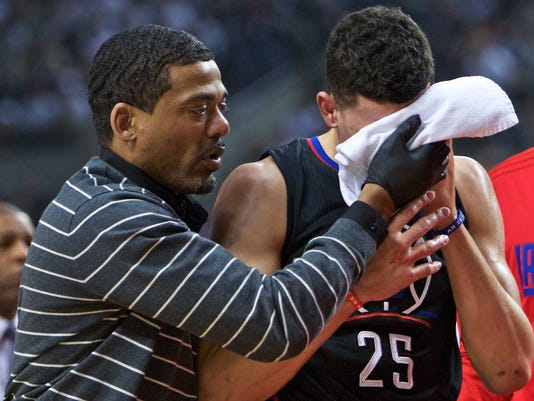 Los Angeles Clippers guard Austin Rivers (25) leaves the court after an injury, during the first half of Game 6 of an NBA basketball first-round playoff series against the Portland Trail Blazers on Friday, April 29, 2016, in Portland, Ore. (AP Photo/Craig Mitchelldyer)