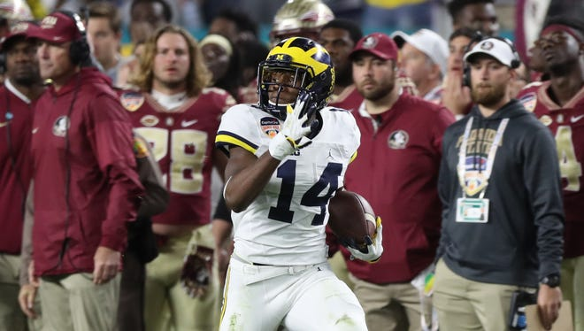 Michigan's Josh Metellus runs back a blocked extra point against Florida State late in U-M's 33-32 loss in the Orange Bowl on Dec. 30, 2016 in Miami Gardens, Fla.